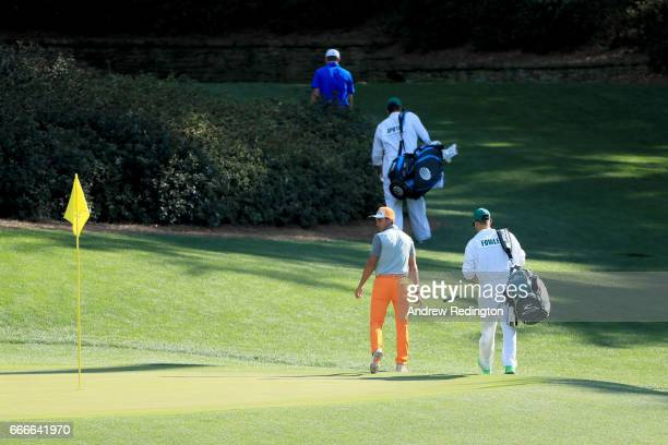 Rickie Fowler of the United States and Jordan Spieth of the United States walk off during the final round of the 2017 Masters Tournament at Augusta...