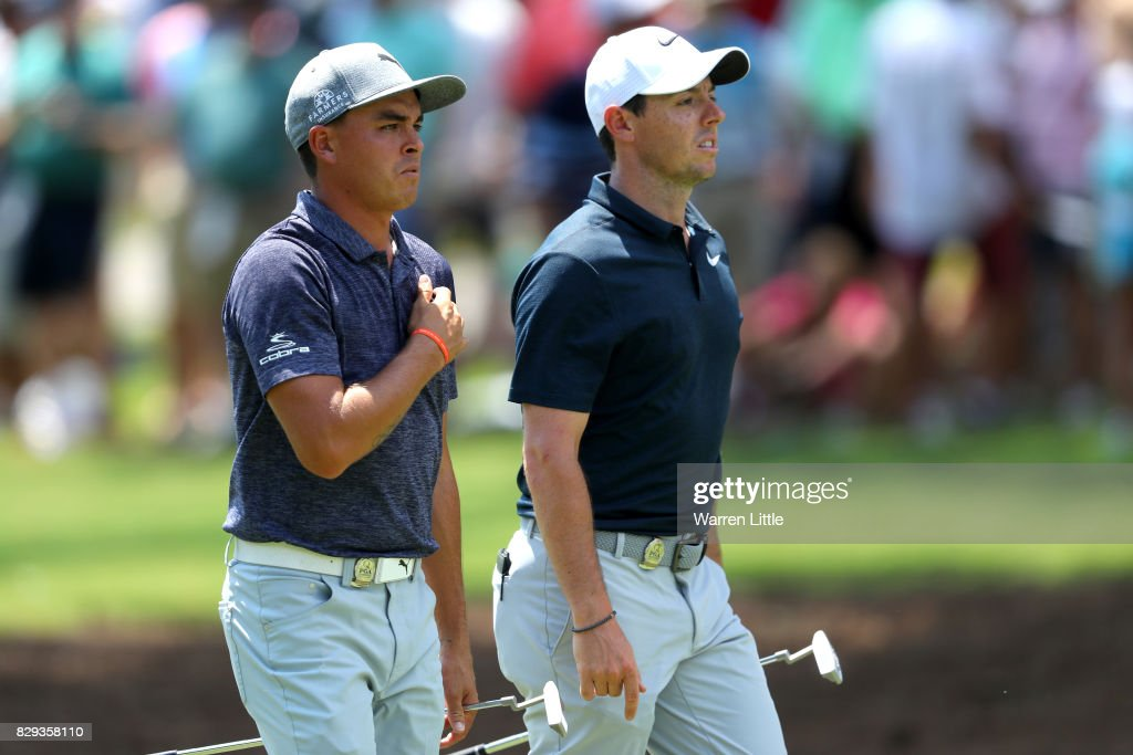Rickie Fowler of the United States and Rory McIlroy of Northern Ireland walk along the second hole during the first round of the 2017 PGA Championship at Quail Hollow Club on August 10, 2017 in Charlotte, North Carolina.