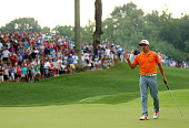 Rickie Fowler of the United States celebrates a putt for birdie on the tenth hole during the final round of the 96th PGA Championship at Valhalla...