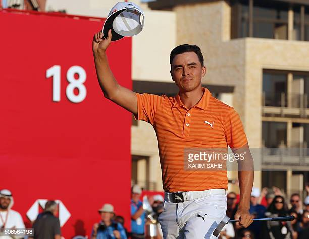 Rickie Fowler of the United States celebrates after winning the final round of the Abu Dhabi Golf Championship in the capital of the United Arab...