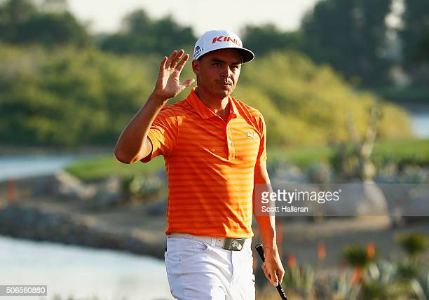 Rickie Fowler of the United States celebrates chipping in for birdie on the 17th green during round four of the Abu Dhabi HSBC Golf Championship at...