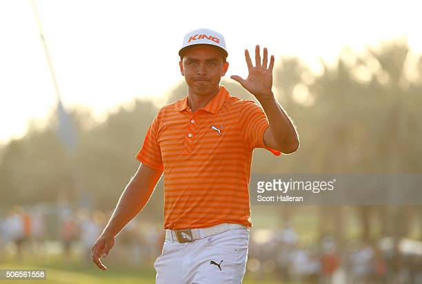 Rickie Fowler of the United States celebrates victory on the 18th green during round four of the Abu Dhabi HSBC Golf Championship at the Abu Dhabi...