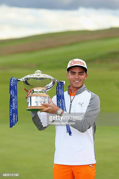 Rickie Fowler of the United States celebrates with the trophy after winning the Aberdeen Asset Management Scottish Open at Gullane Golf Club on July...