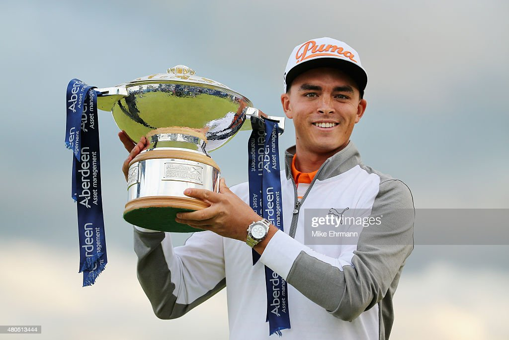 Rickie Fowler of the United States celebrates with the trophy during the trophy presentation after winning the Aberdeen Asset Management Scottish Open at Gullane Golf Club on July 12, 2015 in Gullane, East Lothian, Scotland.