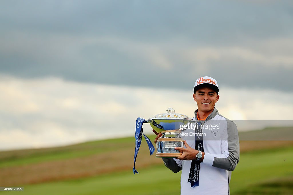 <a gi-track='captionPersonalityLinkClicked' href=/galleries/search?phrase=Rickie+Fowler&family=editorial&specificpeople=4466576 ng-click='$event.stopPropagation()'>Rickie Fowler</a> of the United States celebrates with the trophy during the trophy presentation after winning the Aberdeen Asset Management Scottish Open at Gullane Golf Club on July 12, 2015 in Gullane, East Lothian, Scotland.