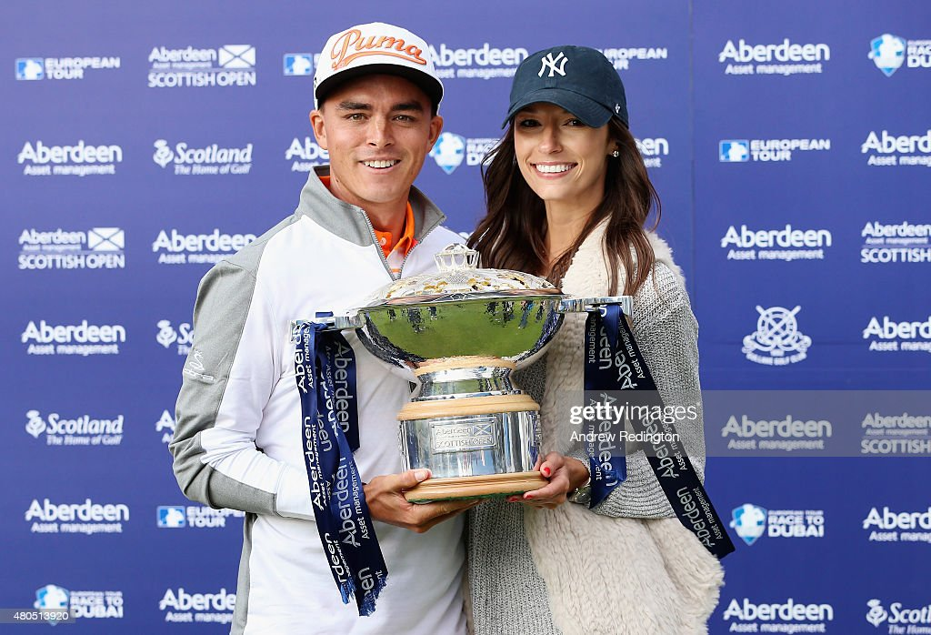 Rickie Fowler of the United States celebrates with the trophy alongside his girlfriend, Alexis Randock, after winning the Aberdeen Asset Management Scottish Open at Gullane Golf Club on July 12, 2015 in Gullane, East Lothian, Scotland.