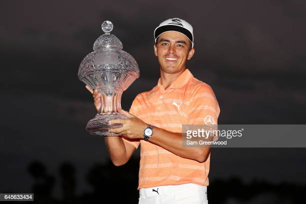Rickie Fowler of the United States celebrates with the winner's trophy after the final round of The Honda Classic at PGA National Resort and Spa on...