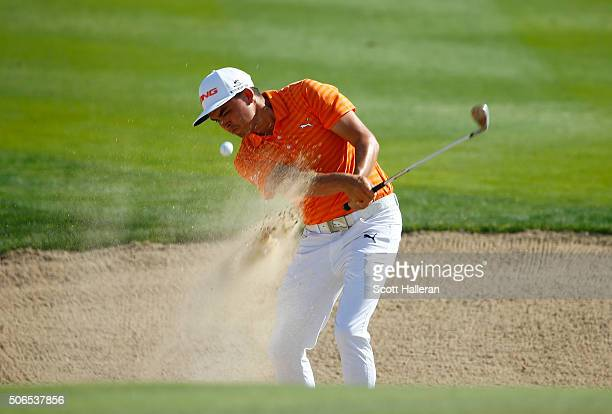 Rickie Fowler of the United States chips in from the bunker for eagle on the 8th hole during round four of the Abu Dhabi HSBC Golf Championship at...