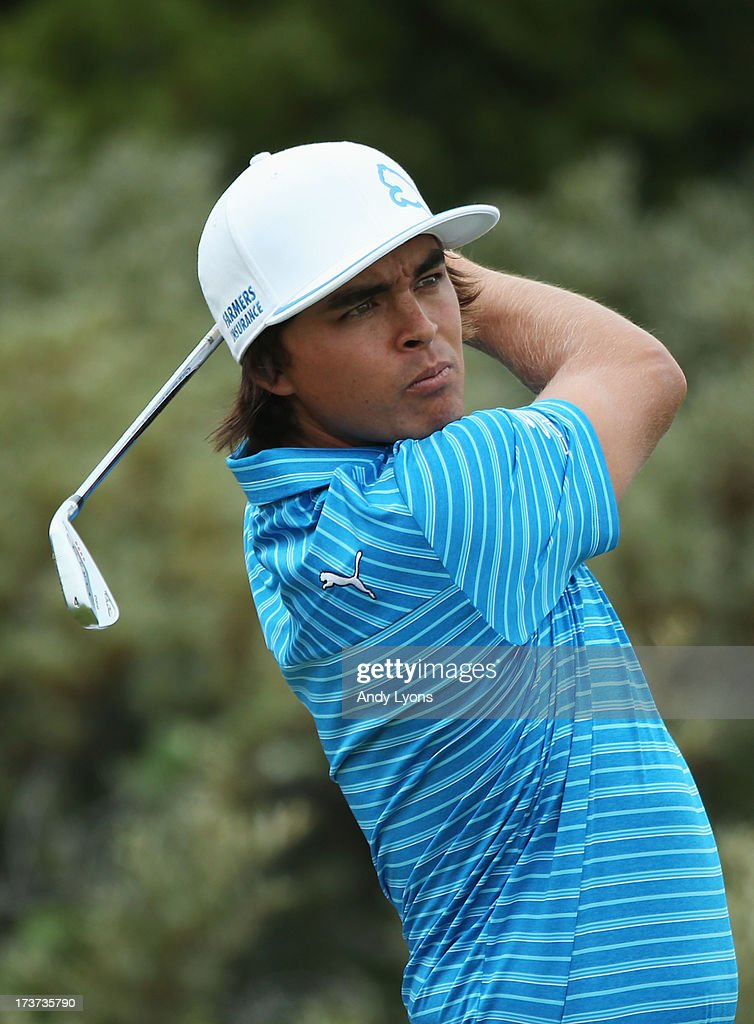 <a gi-track='captionPersonalityLinkClicked' href=/galleries/search?phrase=Rickie+Fowler&family=editorial&specificpeople=4466576 ng-click='$event.stopPropagation()'>Rickie Fowler</a> of the United States hits a shot ahead of the 142nd Open Championship at Muirfield on July 17, 2013 in Gullane, Scotland.