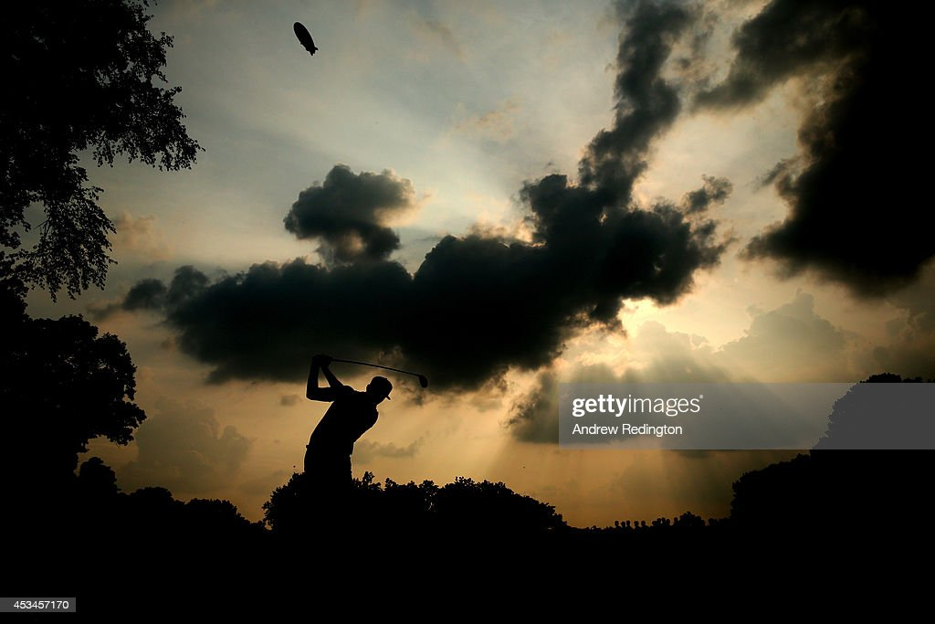 Rickie Fowler of the United States hits his tee shot on the 12th hole during the final round of the 96th PGA Championship at Valhalla Golf Club on...