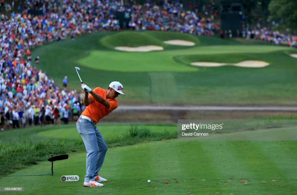 Rickie Fowler of the United States hits his tee shot on the 14th hole during the final round of the 96th PGA Championship at Valhalla Golf Club on...