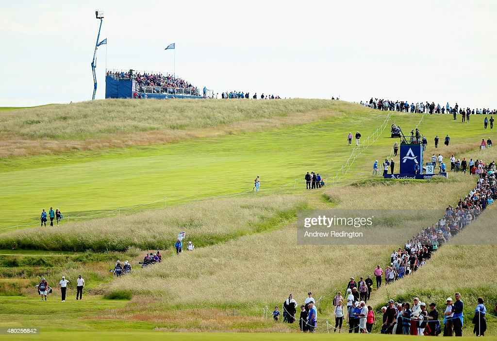 Rickie Fowler of the United States, Ian Poulter of England and Jamie Donaldson of Wales walk down the 18th hole as a crowd follows during the second round of the Aberdeen Asset Management Scottish Open at Gullane Golf Club on July 10, 2015 in Gullane, East Lothian, Scotland.