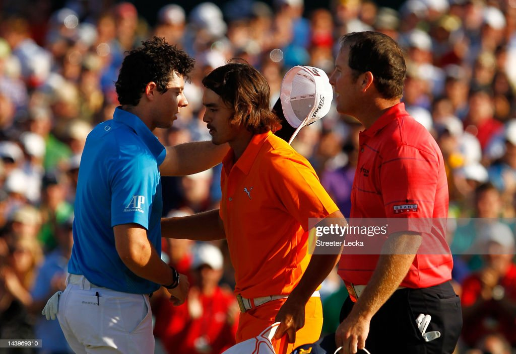 <a gi-track='captionPersonalityLinkClicked' href=/galleries/search?phrase=Rickie+Fowler&family=editorial&specificpeople=4466576 ng-click='$event.stopPropagation()'>Rickie Fowler</a> (C) of the United States is congratulated by Rory McIlroy (L) of Northern Ireland and <a gi-track='captionPersonalityLinkClicked' href=/galleries/search?phrase=D.A.+Points&family=editorial&specificpeople=2130541 ng-click='$event.stopPropagation()'>D.A. Points</a> (R) of the United States after making a putt for birdie on the first playoff hole during the final round to win the Wells Fargo Championship at the Quail Hollow Club on May 6, 2012 in Charlotte, North Carolina.