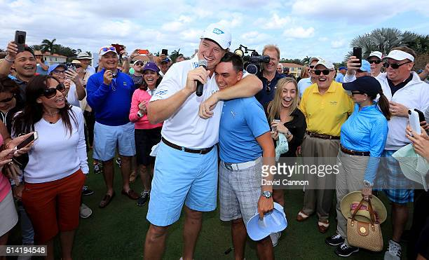 Rickie Fowler of the United States is embraced by Ernie Els after he had just holed in one in the $1 million HoleInOne Challenge sponsored by SAP and...