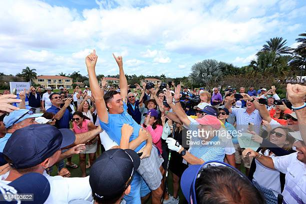 Rickie Fowler of the United States is held aloft by Ernie Els after he had just holed in one in the $1 million HoleInOne Challenge sponsored by SAP...
