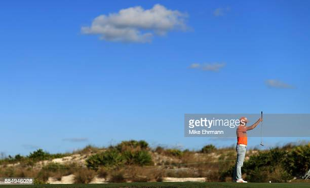 Rickie Fowler of the United States lines up a putt on the 16th hole during the final round of the Hero World Challenge at Albany Bahamas on December...