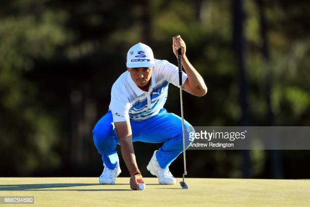 Rickie Fowler of the United States lines up a putt on the 18th hole during the third round of the 2017 Masters Tournament at Augusta National Golf...
