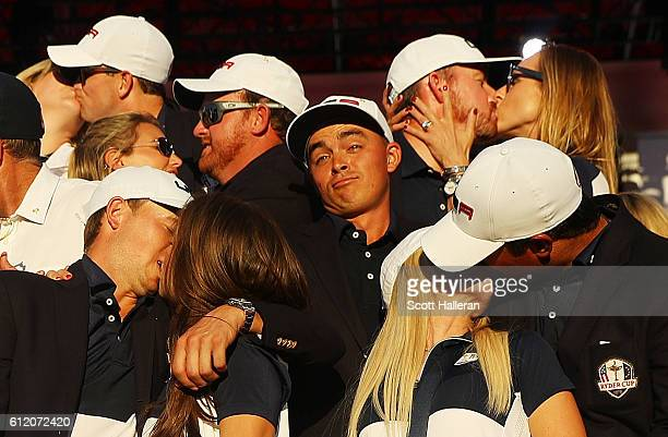 Rickie Fowler of the United States looks on as Kim Johnson Zach Johnson JB Holmes Erica Holmes Jimmy Walker Erin Walker Jordan Spieth Annie Verret...