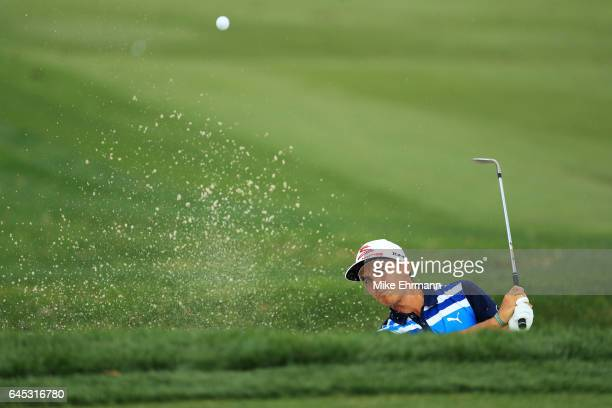 Rickie Fowler of the United States plays a shot from a bunker on the fourth hole during the third round of The Honda Classic at PGA National Resort...