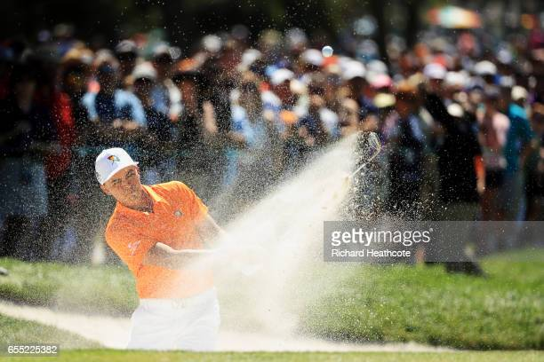 Rickie Fowler of the United States plays a shot from a bunker on the first hole during the final round of the Arnold Palmer Invitational Presented By...