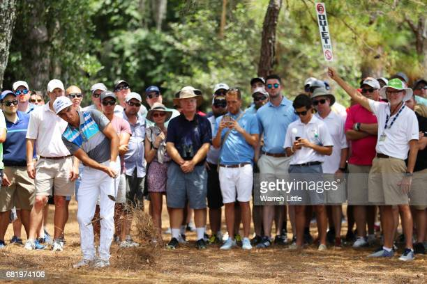Rickie Fowler of the United States plays a shot on the sixth hole during the first round of THE PLAYERS Championship at the Stadium course at TPC...