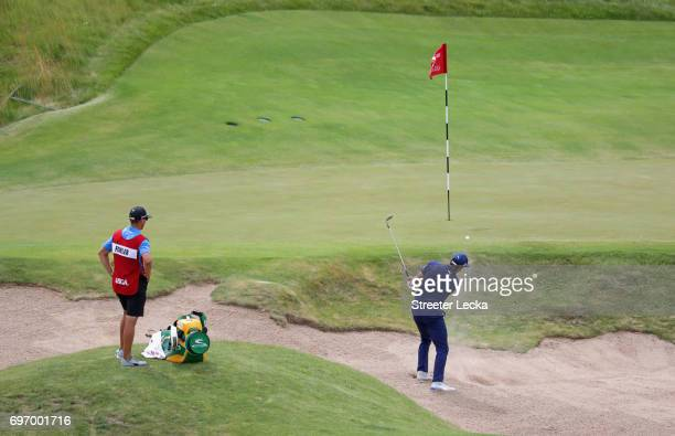 Rickie Fowler of the United States plays his shot from a bunker on the fourth hole during the third round of the 2017 US Open at Erin Hills on June...