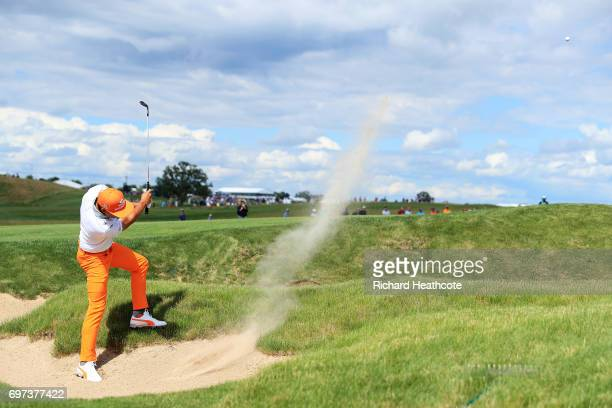 Rickie Fowler of the United States plays his shot from a bunker on the fifth hole during the final round of the 2017 US Open at Erin Hills on June 18...