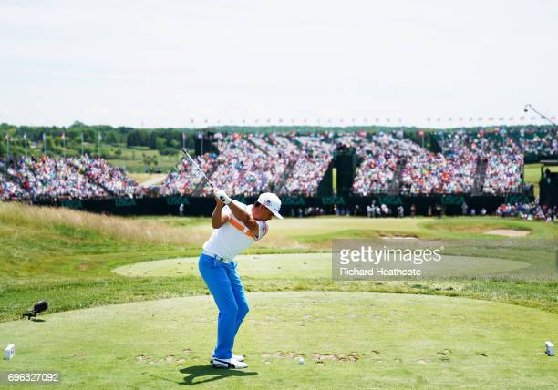 Rickie Fowler of the United States plays his shot from the ninth tee during the first round of the 2017 US Open at Erin Hills on June 15 2017 in...
