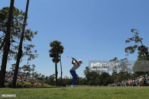 Rickie Fowler of the United States plays his shot from the third tee during the second round of THE PLAYERS Championship at the Stadium course at TPC...