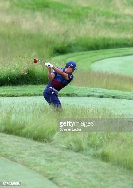 Rickie Fowler of the United States plays his shot on the 15th hole during the third round of the 2017 US Open at Erin Hills on June 17 2017 in...