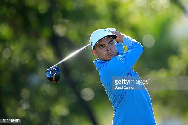 Rickie Fowler of the United States plays his tee shot at the par 4 14th hole during the second round of the 2016 Honda Classic held on the PGA...