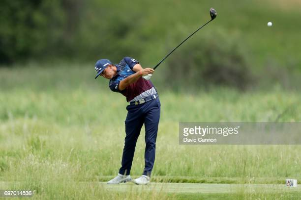 Rickie Fowler of the United States plays his tee shot at the par 4 second hole during the third round of the 117th US Open Championship at Erin Hills...