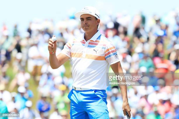 Rickie Fowler of the United States reacts after finishing on the ninth green during the first round of the 2017 US Open at Erin Hills on June 15 2017...