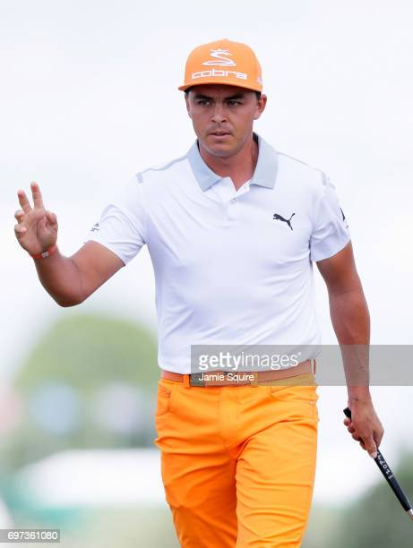 Rickie Fowler of the United States reacts after making a birdie on the first green during the final round of the 2017 US Open at Erin Hills on June...