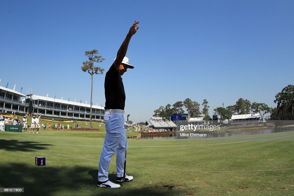 Rickie Fowler of the United States reacts after making a hole in one on the 17th hole during a practice round prior to THE PLAYERS Championship at the Stadium course at TPC Sawgrass on May 10, 2017 in Ponte Vedra Beach, Florida.