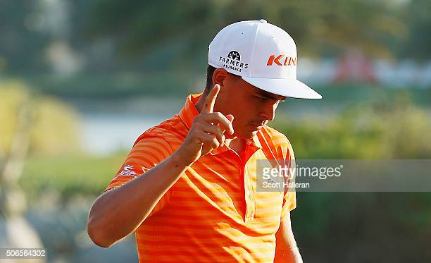 Rickie Fowler of the United States reacts to a birdie on the 17th hole during the final round of the Abu Dhabi HSBC Golf Championship at the Abu...