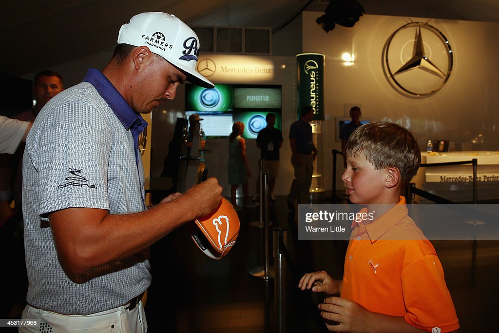 <a gi-track='captionPersonalityLinkClicked' href=/galleries/search?phrase=Rickie+Fowler&family=editorial&specificpeople=4466576 ng-click='$event.stopPropagation()'>Rickie Fowler</a> of the United States signs his autograph for a fan in the Mercedes Benz Performance Centre during a practice round prior to the start of the 96th PGA Championship at Valhalla Golf Club on August 4, 2014 in Louisville, Kentucky.
