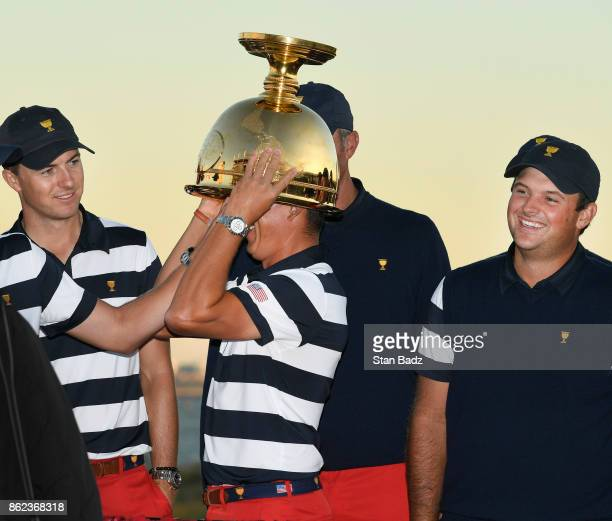 Rickie Fowler of the United States Team lift's the Presidents Cup trophy during the Sunday singles matches at the Presidents Cup at Liberty National...