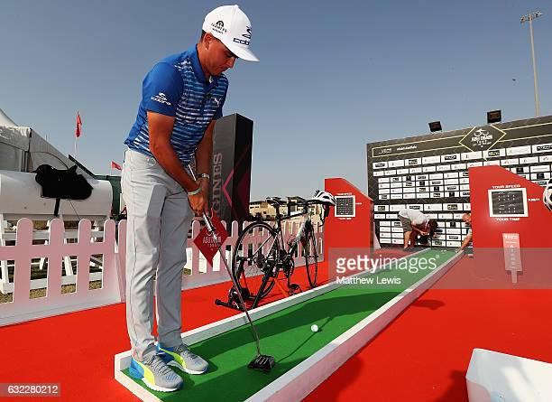 Rickie Fowler of the United States visits the Abu Dhabi Tour Stand in the Championship village during day three of the Abu Dhabi HSBC Championship at...