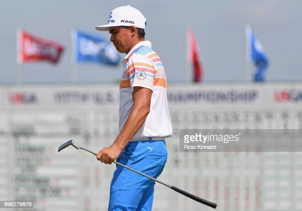 Rickie Fowler of the United States walks across the 18th green during the first round of the 2017 US Open at Erin Hills on June 15 2017 in Hartford...