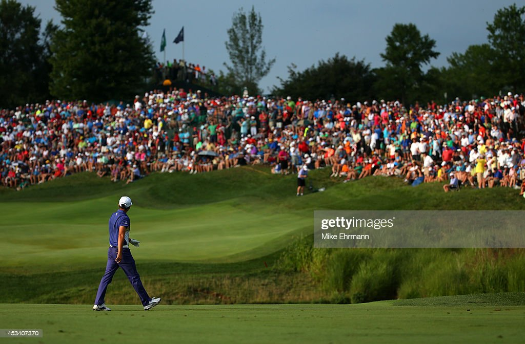 <a gi-track='captionPersonalityLinkClicked' href=/galleries/search?phrase=Rickie+Fowler&family=editorial&specificpeople=4466576 ng-click='$event.stopPropagation()'>Rickie Fowler</a> of the United States walks across the 18th hole during the third round of the 96th PGA Championship at Valhalla Golf Club on August 9, 2014 in Louisville, Kentucky.