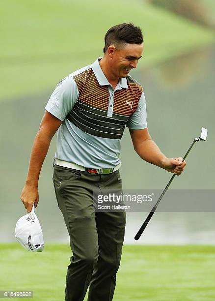 Rickie Fowler of the United States walks off the ninth green after a sevenunder par 65 during the first round of the WGC HSBC Champions at the...