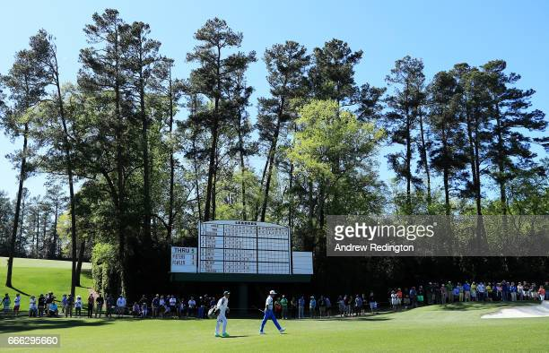 Rickie Fowler of the United States walks on the sixth hole during the third round of the 2017 Masters Tournament at Augusta National Golf Club on...