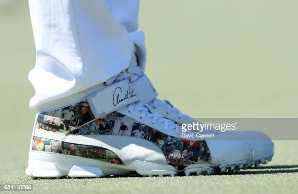 Rickie Fowler of the United States wears a very special tribute pair of golf shoes adorned with the signature and images of Arnold Palmer during the...