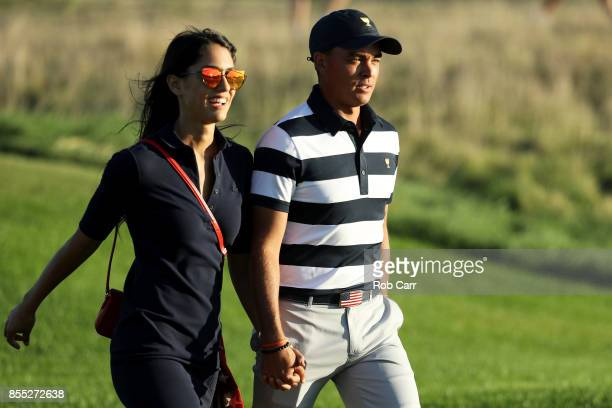 Rickie Fowler of the US Team and girlfriend Allison Stokke walk on the 17th hole during Thursday foursome matches of the Presidents Cup at Liberty...