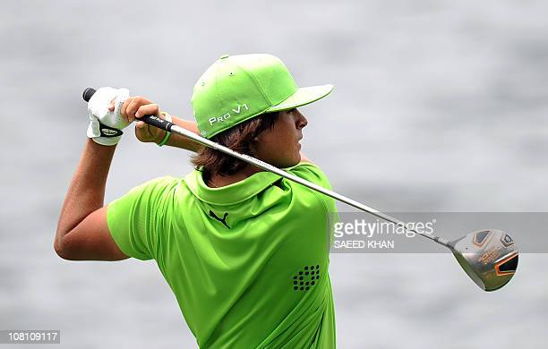 Rickie Fowler of the US tees off on the 11th hole during the third round of the CIMB Asia Pacific Classic Malaysia 2010 golf tournament in Kuala...