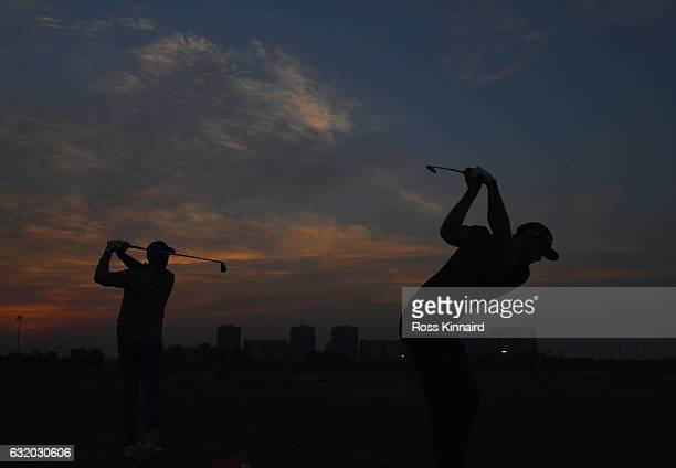 Rickie Fowler of the USA and Dustin Johnson of the USA on the practice range during the first round of the Abu Dhabi HSBC Championship at Abu Dhabi...