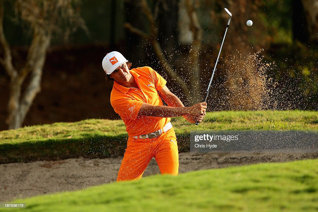 <a gi-track='captionPersonalityLinkClicked' href=/galleries/search?phrase=Rickie+Fowler&family=editorial&specificpeople=4466576 ng-click='$event.stopPropagation()'>Rickie Fowler</a> of the USA chips out of the bunker during day four of the PGA Royal Pines on November 10, 2013 in Gold Coast, Australia.
