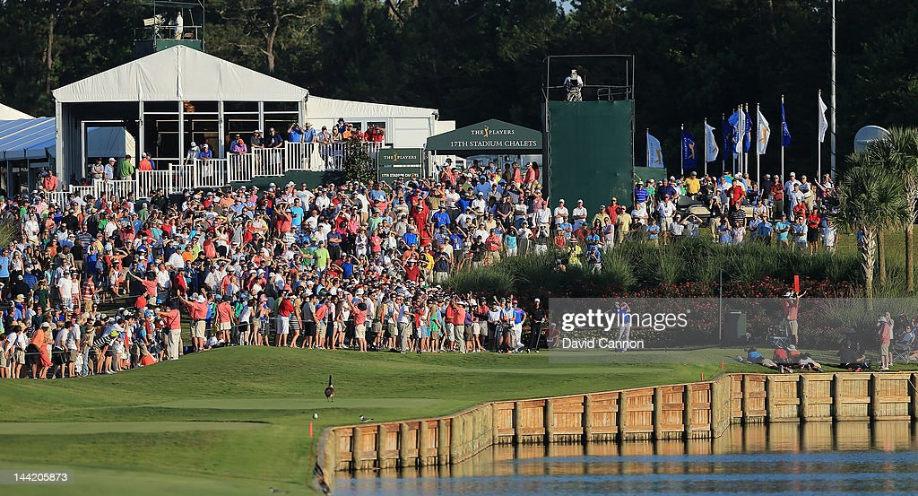 <a gi-track='captionPersonalityLinkClicked' href=/galleries/search?phrase=Rickie+Fowler&family=editorial&specificpeople=4466576 ng-click='$event.stopPropagation()'>Rickie Fowler</a> of the USA plays his tee shot at the par 4, 18th hole during the second round of THE PLAYERS Championship held at THE PLAYERS Stadium course at TPC Sawgrass on May 11, 2012 in Ponte Vedra Beach, Florida.