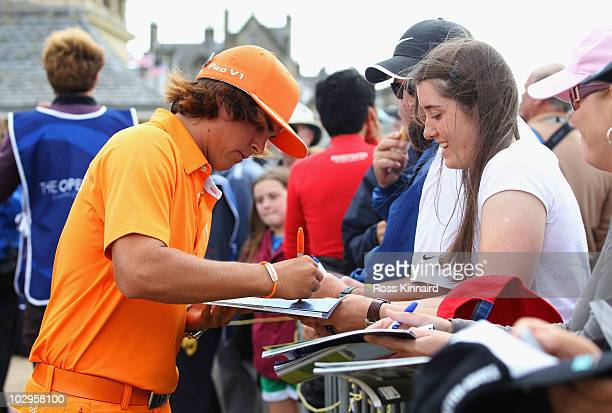 Rickie Fowler of the USA signs autographs for fans during the final round of the 139th Open Championship on the Old Course St Andrews on July 18 2010...